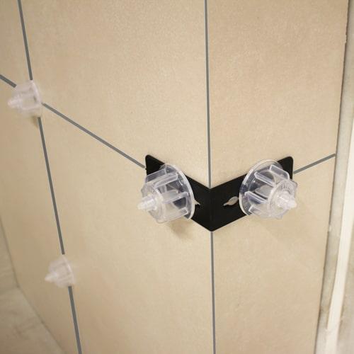 Nivellierecken schwarz mit Nivelliersystem Zughauben transparent liesenverlegung an Kanten, Treppen, Innen und Außenecken - KARL DAHM